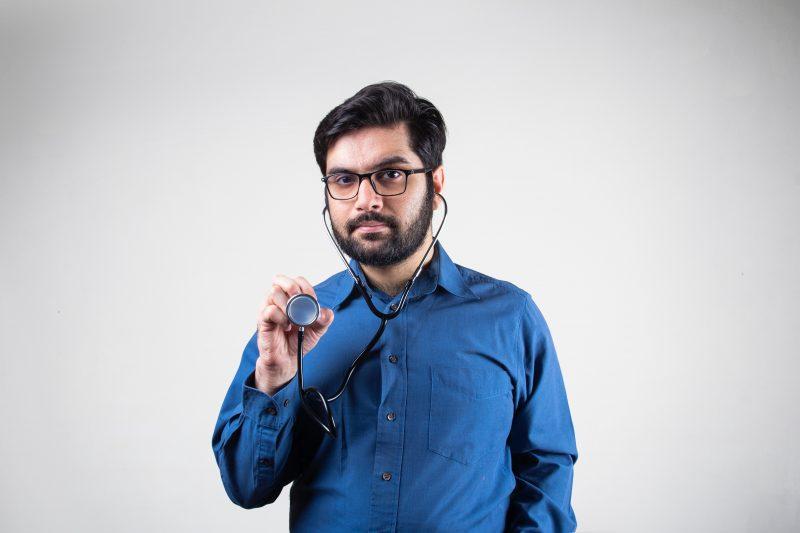 man in blue dress shirt smiling